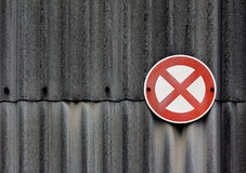 No stopping sign on asbestos wall Royalty Free Stock Images
