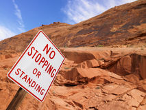 No Stopping Sign With Rock Face in Background Royalty Free Stock Image