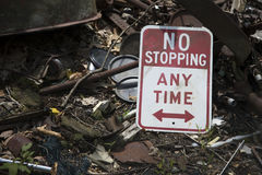 No stopping sign on trash Royalty Free Stock Photography