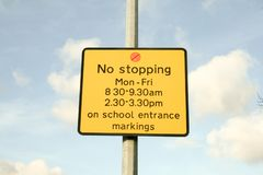 No stopping sign yellow outside lamp post royalty free stock photography