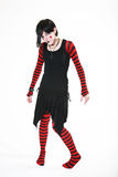 No Strings Attached. Gothic, raggedy ann style puppet stands awkwardly with no strings attached Stock Photo