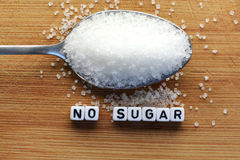 No sugar phrase made from plastic letter cubes placed in a spoon full of sugar Stock Photography