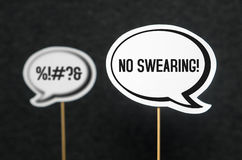 No swearing, bad language and words. Swearing, cursing and bad language or behaviour in school, work or life. Speech bubble telling the other not to swear Stock Images