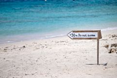 No swim signal. In a white sand beach Royalty Free Stock Images