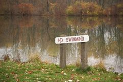 No Swimming. Sign at the edge of a lake in North Eastern Ohio Stock Images