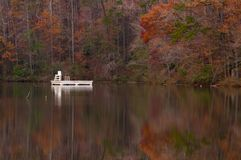 Asylum Lake at Paris Mountain State Park, Greenville, South Carolina in Autumn. No swimming in the autumn on Asylum Lake at Paris Mountain State Park in stock photos