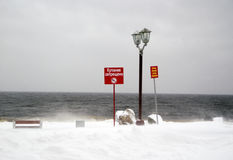 No swimming. City seafront in winter. Stock Photos