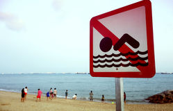 A no swimming danger sign Stock Images