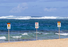 No swimming danger sign Tunnels Beach Royalty Free Stock Image