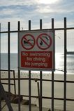 No swimming diving or jumping sign. Stock Photos