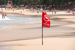 No Swimming Flag warning on the beach Royalty Free Stock Image