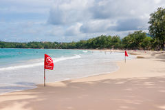 No Swimming Flag warning on the beach Stock Images