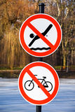 No swimming and no cycling traffic signs. In the park Stock Photo