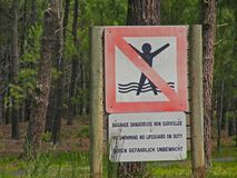 No swimming no lifeguard on duty sign, on coast of Atlantique from Bordeaux stock photography
