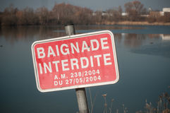 No swimming panel in french in front of lake baignad Royalty Free Stock Photos