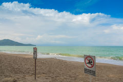 No swimming sign on  beach . Stock Photos