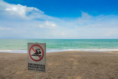 No swimming sign on  beach . Royalty Free Stock Photo