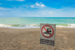 No swimming sign on  beach . Stock Photo