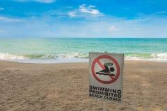 No swimming sign on beach . Stock Photo