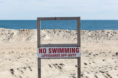 No Swimming Sign on Beach Stock Images