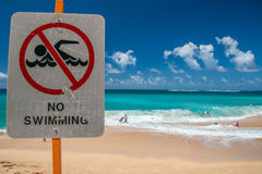 No swimming sign in Hawaii Poipu beach landscape Stock Photo