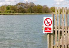 No swimming sign on jetty Royalty Free Stock Image