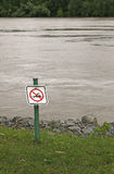No Swimming Sign. Posted at edge of picnic area on riverbank Stock Image