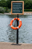 No swimming sign with rescue ring. Sign stating no swimming at Hyde Park London Stock Images