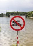 No swimming sign with rough lake Royalty Free Stock Photography