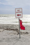 No Swimming sign. A no swimming warning sign on the beach Royalty Free Stock Photos