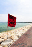 No Swmming Warning, Bali, Indonesia. Image of a no swimming warning flag usually put up when the sea is dangerous at Kuta, Bali, Indonesia Royalty Free Stock Image