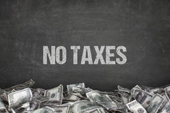 No taxes text on black background. With dollar pile royalty free stock photo