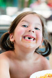 No teeth little girl. Adorable girl smiling with no front teeth Stock Image