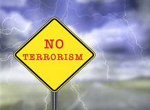 No Terrorism warning sign. Illustration depicting warning sign with No Terrorism concept. Blurred stormy sky background Royalty Free Stock Images