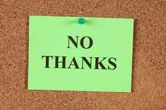 No Thanks. Green post-it note saying No Thanks on corkboard (bulletin board). Close-up Royalty Free Stock Photos