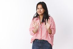 No thanks I fine. Portrait of awkward woman saying sorry refusing offer, waving palms near chest reluctant, smirking and royalty free stock photography