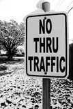 No thru trafic sign with snow. A high contrast scene with a tree and snow and a sign Stock Image