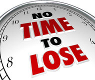 No Time to Lose Clock Words Deadline Countdown. No Time to Lose saying or quote on a white clock face to illustrate a rush or hurry to complete a task or job in Stock Photo