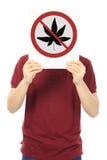 No to Marijuana. A young man holding a sign against use of marijuana Royalty Free Stock Image