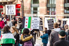 No to Russian weapons being sell to Syrian regime placard at pro. STRASBOURG, FRANCE MAR 19, 2016: No to Russian weapons being sell to Syrian regime - placard at Royalty Free Stock Photos