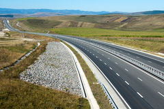 No traffic in the morning. Low traffic on a highway, early in the morning Stock Photography