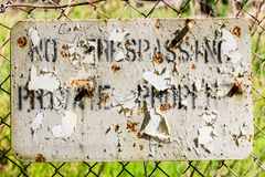 No Trespass beat but readable. No trespass, worn and shot but readable royalty free stock photography