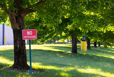 No Trespass. Ing sign amidst a line of trees royalty free stock image