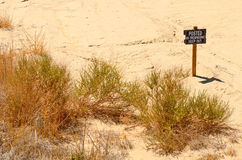 No Trespass. Ing sign at the side of a desert sand expanse in Nevada stock images