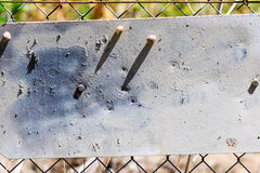 No Trespass words gone. No Trespass sign worn out and blank from age, peeling gray paint stock photography