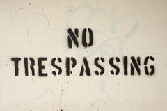 No trespassing. Stenciled on a wall Stock Images