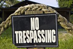 No Trespassing. Sign at dock of home Stock Photos