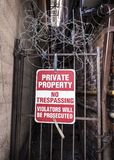 No Trespassing Alley with barbed wire stock images
