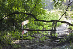 No trespassing. Barricade of Construction barriers and branches stock images