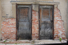 No Trespassing Doors. A pair of doors on a derelict building Royalty Free Stock Image